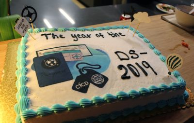 """The Year of the DS-2019"" cake"